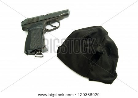 black mask and gun on white background
