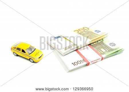 Yellow Taxi Car And Banknotes