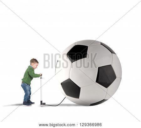 Baby boy amused swollen a big soccer ball