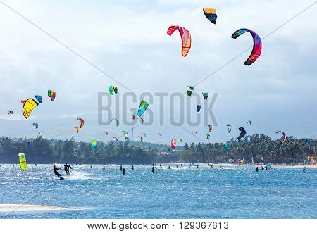 Kitesurfers enjoying wind power on Bulabog beach, Boracay island, Philippines
