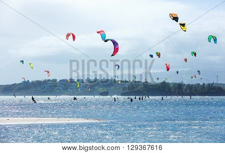Kitesurfers enjoying wind power on Bulabog beach, Boracay island, Philippines
