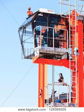 Cockpit of modern crane industry detail. Blue sky background