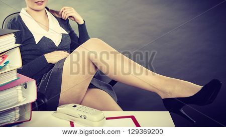 Relaxed Secretary With Traditional Phone.