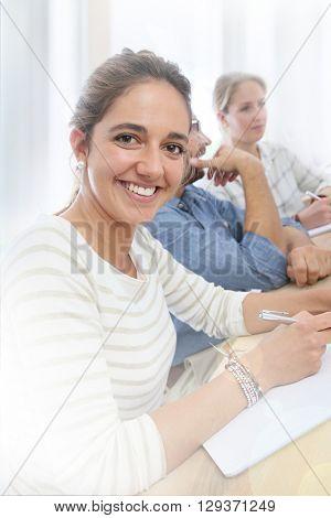 Portrait of smiling brunette school girl in class