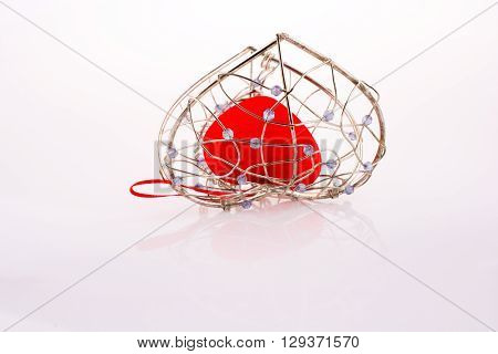 Heart in Heart cage on a white background