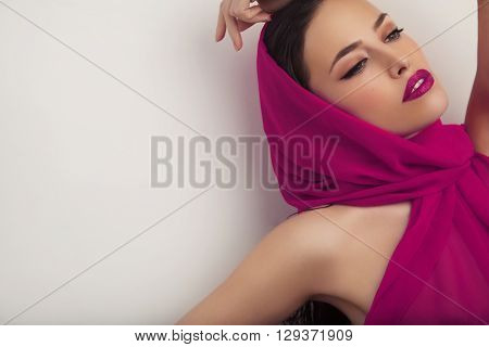 beautiful woman portrait with scarf and makeup studio white