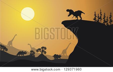 Silhouette of brachiosaurus and ankylosaurus at the afternoon