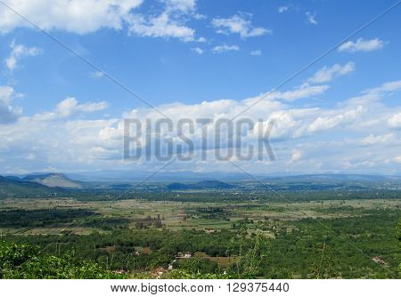 Amazing Croatian countryside panorama with clouds and blue sky