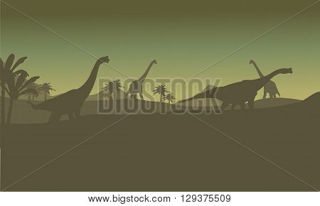 Silhouette of many brachiosaurus in hills at the night