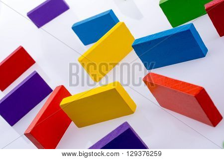 various Color dominoes are placed a white background