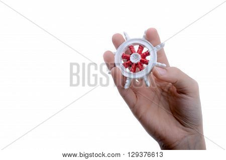 Isolated  white and red color ship steering wheel in hand