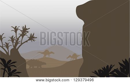 Silhouette of ankylosaurus and spinosaurus in hills with brown backgrounds
