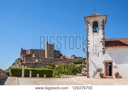 Marvao medieval Castle and Santa Maria Church, currently the municipal museum. Mavao, Portalegre District, Alto Alentejo, Portugal. Marvao was a candidate to World Heritage Site by UNESCO.