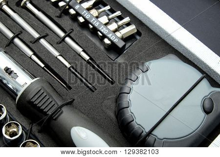 Close up of set of tools in box. Focus on center.