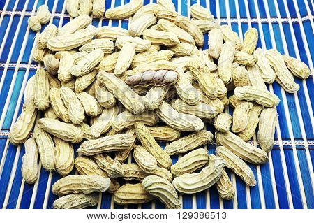 Boiled peanuts with an opened nut. Focus on an opened peanut.