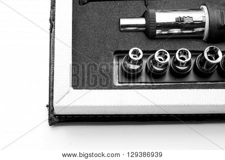 Close up of corner of tool box with screwdriver and adjustable torque. Isolated on white. Space for texts.