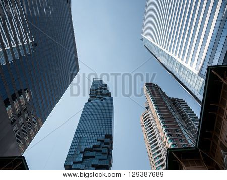 Modern high building in Bangkok with blue sky background