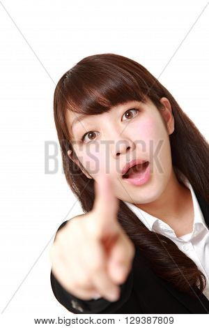 portrait of young Japanese businesswoman discover something on white background