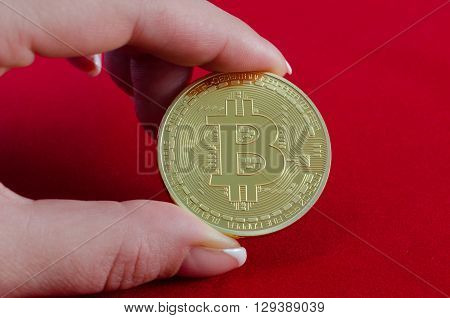 Golden Bitcoins (digital Virtual Money) In Hand On Red Background