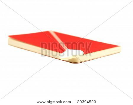 White heart on the open red book isolated on white background, select focus.