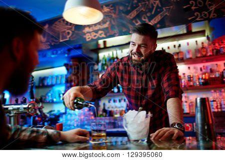 Barman pouring whiskey