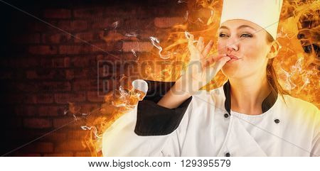 Portrait of a woman chef satisfying against image of a wall