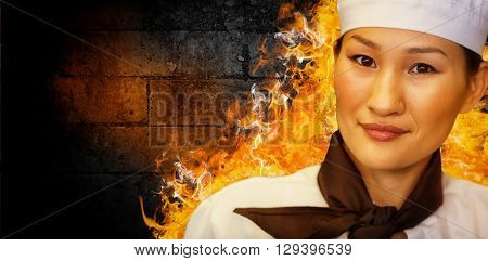 Closeup portrait of a smiling female cook against green wall