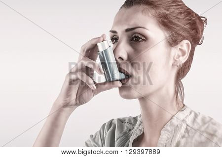 Portrait of a asthmatic woman against blue background