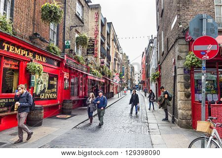 DUBLIN IRELAND - 05 MAY 2016: Tourists walking in the Temple Bar area. The place is the cultural quarter in the center of the city and is full of restaurants bars and nightclubs.