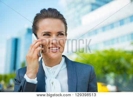 Happy Business Woman In Office District Talking Smartphone