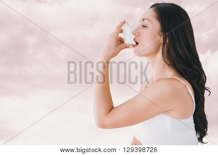 Image of an asthmatic woman against light grey