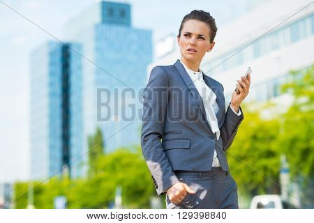 Business Woman With Cell Phone In Modern Office District
