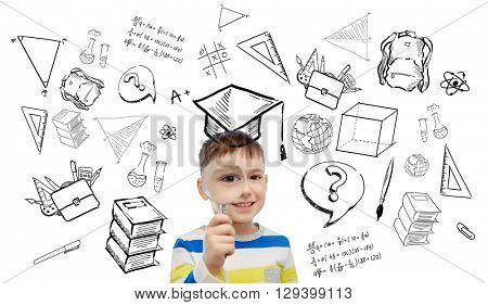childhood, school, education, learning and people concept - happy little boy looking through magnifying glass with doodles