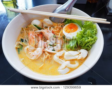 Tom yum kung soup with noodle and boiled egg.Hot and spicy Thai soup.