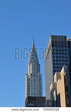 Chrysler Building against a clear blue sky.