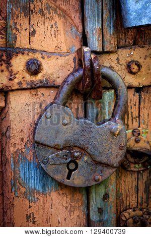 old rusty lock on wooden door