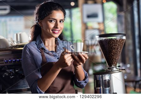 Female barista preparing coffee in Indian Cafe