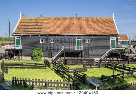 Wooden Cottage At The Lake In Enkhuizen
