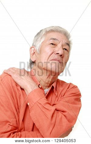 portrait of senior Japanese man suffers from neck ache on white background