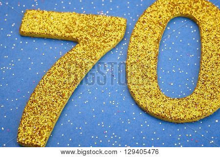 Number seventy yellow color over a blue background. Anniversary. Horizontal