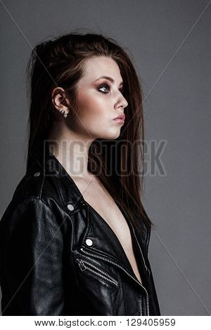 young pretty sexy woman in leather jacket closeup portrait