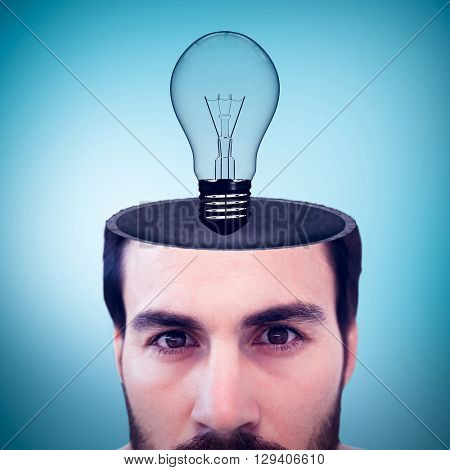 Close up of focused businessman against blue vignette background