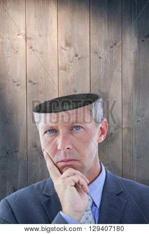 Business team thinking against bleached wooden planks background