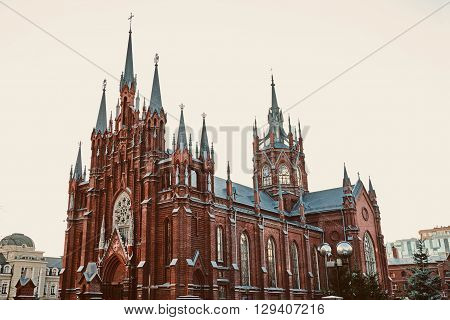 Moscow Gothic Catholic cathedral against the autumn sky