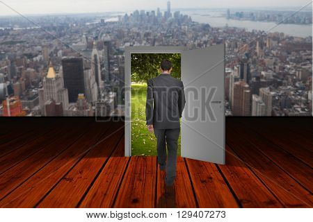 Businessman walking against wooden planks