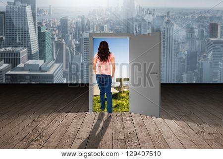Pretty brunette stepping against wooden planks