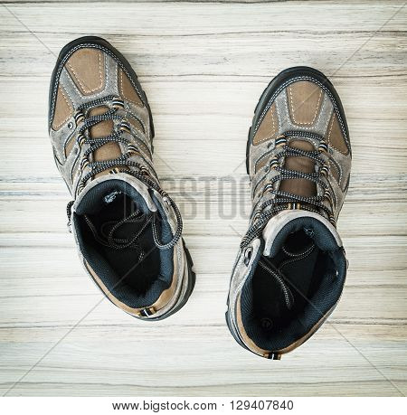 Pair of stylish teenage outdoor shoes on the wooden background. Beauty and fashion. New shoes. Shoe store. Fashion collection.