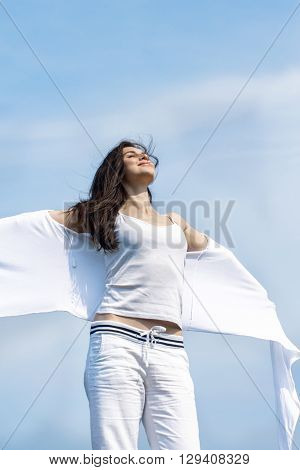 Girl Stands On The Background Of The Sky