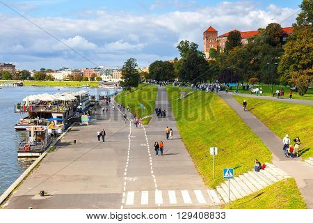 Krakow, Poland - September 27, 2015: People Are Walking Along The Vistula River Bank In The Historic