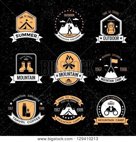 Mountaineering vintage emblems on black background with grey small spots with tools for climbing isolated vector illustration